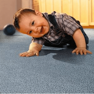 child laying on carpet